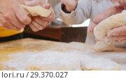 Купить «Family making little pies. Shaping dough. Slow motion», видеоролик № 29370027, снято 6 июля 2020 г. (c) Константин Шишкин / Фотобанк Лори