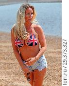 Купить «Reality Star Danielle Mason wearing her patriotic Union Jack bikini on Chalkwell Beach, Essex earlier today. Featuring: Danielle Mason Where: Chalkwell...», фото № 29373327, снято 21 мая 2018 г. (c) age Fotostock / Фотобанк Лори