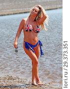 Купить «Reality Star Danielle Mason wearing her patriotic Union Jack bikini on Chalkwell Beach, Essex earlier today. Featuring: Danielle Mason Where: Chalkwell...», фото № 29373351, снято 21 мая 2018 г. (c) age Fotostock / Фотобанк Лори