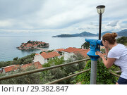 Купить «Sveti Stefan island and Adriatic sea in panorama from coin operated binoculars in hill of town. Montenegro, Europe», фото № 29382847, снято 3 июня 2016 г. (c) Кекяляйнен Андрей / Фотобанк Лори