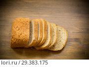 Купить «fresh homemade bread sliced on wooden background», фото № 29383175, снято 6 ноября 2018 г. (c) Peredniankina / Фотобанк Лори