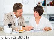 Man and woman with cups coffee and documents. Стоковое фото, фотограф Яков Филимонов / Фотобанк Лори
