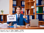 Купить «Young employee working in the office», фото № 29385275, снято 9 августа 2018 г. (c) Elnur / Фотобанк Лори