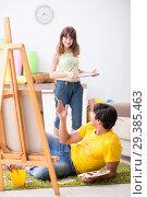 Купить «Young couple enjoying painting at home», фото № 29385463, снято 11 июля 2018 г. (c) Elnur / Фотобанк Лори