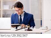 Купить «Young lawyer playing chess to train his court strategy and tacti», фото № 29392567, снято 31 июля 2018 г. (c) Elnur / Фотобанк Лори