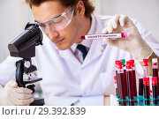 Купить «Young handsome lab assistant testing blood samples in hospital», фото № 29392839, снято 31 августа 2018 г. (c) Elnur / Фотобанк Лори