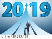 Купить «Businessman running into year of 2019», фото № 29393155, снято 23 мая 2019 г. (c) Elnur / Фотобанк Лори