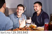 Купить «Happy males talking over beer with pizza at home», фото № 29393843, снято 10 января 2018 г. (c) Яков Филимонов / Фотобанк Лори
