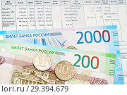 Купить «Деньги лежат на квитанции», эксклюзивное фото № 29394679, снято 19 августа 2018 г. (c) Dmitry29 / Фотобанк Лори