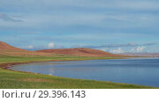 Купить «Calm waters of mongolian lake Telmen Lake surrounded by hills and deserts in north Mongolia», видеоролик № 29396143, снято 10 июля 2018 г. (c) Serg Zastavkin / Фотобанк Лори