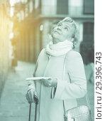 Купить «Mature woman with map and baggage», фото № 29396743, снято 27 ноября 2017 г. (c) Яков Филимонов / Фотобанк Лори