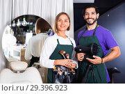 Купить «Woman makeup artist and man hairdresser in the salon», фото № 29396923, снято 22 августа 2019 г. (c) Яков Филимонов / Фотобанк Лори