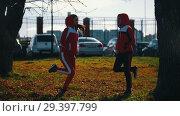 Купить «Two young woman in sport costumes freezing in park.», видеоролик № 29397799, снято 23 июля 2019 г. (c) Константин Шишкин / Фотобанк Лори