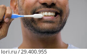 Купить «close up of man with toothbrush cleaning teeth», видеоролик № 29400955, снято 1 ноября 2018 г. (c) Syda Productions / Фотобанк Лори