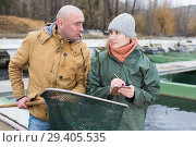 Купить «Owner of sturgeon farm giving instruction to female», фото № 29405535, снято 4 февраля 2018 г. (c) Яков Филимонов / Фотобанк Лори