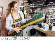 Купить «Woman is choosing modern materials for new fashion collection», фото № 29405543, снято 5 мая 2018 г. (c) Яков Филимонов / Фотобанк Лори