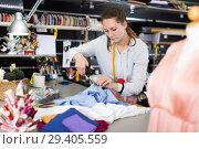 Купить «Woman is doing modern patterns for new fashion collection», фото № 29405559, снято 5 мая 2018 г. (c) Яков Филимонов / Фотобанк Лори