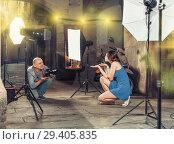 Купить «Photographer shooting female model on city street», фото № 29405835, снято 5 октября 2018 г. (c) Яков Филимонов / Фотобанк Лори