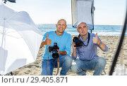 Купить «two photographers with their cameras during professional photo shooting», фото № 29405871, снято 5 октября 2018 г. (c) Яков Филимонов / Фотобанк Лори