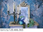 Купить «Старинный подсвечник на винтажном столе», фото № 29406303, снято 10 ноября 2018 г. (c) Марина Володько / Фотобанк Лори