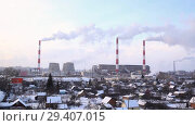 Купить «Industrial landscape. Panoramic view of the technological pipe and industrial infrastructure. Chemical production with red-white pipes and smoke is coming. Production buildings», видеоролик № 29407015, снято 29 октября 2018 г. (c) Mikhail Starodubov / Фотобанк Лори