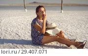 Купить «happy smiling girl enjoying the sunset, eating watermelon, sit on salt, pillars», видеоролик № 29407071, снято 10 ноября 2018 г. (c) Ирина Мойсеева / Фотобанк Лори