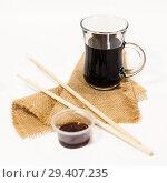 Купить «Soy sauce with sushi chopsticks», фото № 29407235, снято 12 декабря 2018 г. (c) Светлана Кузнецова / Фотобанк Лори