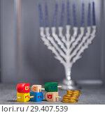 Купить «The Religious symbols of Jewish holiday Hanukkah», фото № 29407539, снято 10 ноября 2018 г. (c) Константин Сенявский / Фотобанк Лори