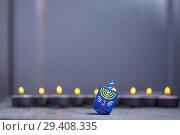 Купить «Defocused lights of Jewish holiday Hanukkah and spinning top», фото № 29408335, снято 10 ноября 2018 г. (c) Константин Сенявский / Фотобанк Лори