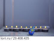 Купить «Defocused lights of Jewish holiday Hanukkah and spinning top», фото № 29408435, снято 10 ноября 2018 г. (c) Константин Сенявский / Фотобанк Лори