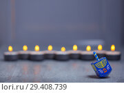 Купить «Defocused lights of Jewish holiday Hanukkah and spinning top», фото № 29408739, снято 10 ноября 2018 г. (c) Константин Сенявский / Фотобанк Лори