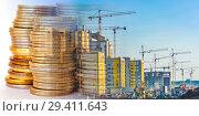 Купить «Панорама строительства на фоне денег», фото № 29411643, снято 6 декабря 2019 г. (c) Сергеев Валерий / Фотобанк Лори