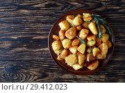 Купить «Crunchy Roast Potatoes on a plate», фото № 29412023, снято 9 ноября 2018 г. (c) Oksana Zh / Фотобанк Лори