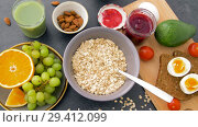 Купить «healthy breakfast of oatmeal and other food», видеоролик № 29412099, снято 2 ноября 2018 г. (c) Syda Productions / Фотобанк Лори