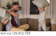 Купить «father and son having pillow fight at home», видеоролик № 29412159, снято 6 ноября 2018 г. (c) Syda Productions / Фотобанк Лори