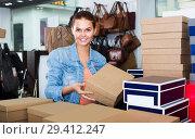 Купить «girl choosing shoes», фото № 29412247, снято 15 сентября 2016 г. (c) Яков Филимонов / Фотобанк Лори