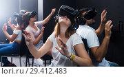 Купить «People wearing virtual reality goggles», фото № 29412483, снято 6 июля 2017 г. (c) Яков Филимонов / Фотобанк Лори