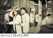 Купить «Adults trying to get out of escape room», фото № 29412495, снято 6 июля 2017 г. (c) Яков Филимонов / Фотобанк Лори