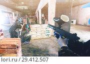 Купить «Gamers are targeting in enemy behind barricades», фото № 29412507, снято 10 июля 2017 г. (c) Яков Филимонов / Фотобанк Лори