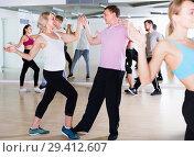 Купить «dancing couples of cheerful men and women learning swing», фото № 29412607, снято 9 октября 2017 г. (c) Яков Филимонов / Фотобанк Лори