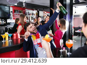 Купить «Cheerful guy expressively dancing partying in bar», фото № 29412639, снято 29 ноября 2017 г. (c) Яков Филимонов / Фотобанк Лори