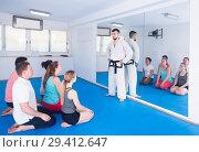 Купить «Coach will give instructions before training on karate», фото № 29412647, снято 8 апреля 2017 г. (c) Яков Филимонов / Фотобанк Лори