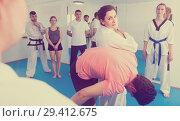 Купить «Woman trainer shows defense methods», фото № 29412675, снято 8 апреля 2017 г. (c) Яков Филимонов / Фотобанк Лори