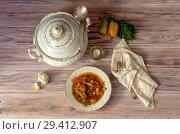 Купить «Plate of borsch on a wooden table (Ukrainian food)», фото № 29412907, снято 26 октября 2018 г. (c) Татьяна Ляпи / Фотобанк Лори