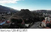 Купить «Gori city in Georgia Stalin's homeland 4K drone flight», видеоролик № 29412951, снято 6 ноября 2018 г. (c) Aleksejs Bergmanis / Фотобанк Лори