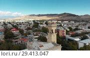 Купить «Gori city in Georgia Stalin's homeland 4K drone flight», видеоролик № 29413047, снято 6 ноября 2018 г. (c) Aleksejs Bergmanis / Фотобанк Лори