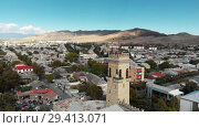 Купить «Gori city in Georgia Stalin's homeland 4K drone flight», видеоролик № 29413071, снято 6 ноября 2018 г. (c) Aleksejs Bergmanis / Фотобанк Лори