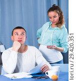 Купить «Husband and pregnant wife arguing at home», фото № 29420351, снято 18 марта 2017 г. (c) Яков Филимонов / Фотобанк Лори