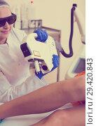 Купить «Female visitor having leg hair removed», фото № 29420843, снято 12 ноября 2019 г. (c) Яков Филимонов / Фотобанк Лори