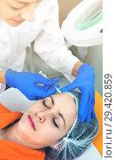 Купить «Woman doctor making beauty injection to young female client», фото № 29420859, снято 20 марта 2019 г. (c) Яков Филимонов / Фотобанк Лори